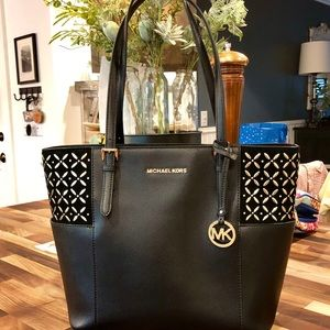 Michael Kors purse black with gold accents